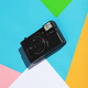 Vintage camera on a colorful geometrical background. - PhotoDune Item for Sale