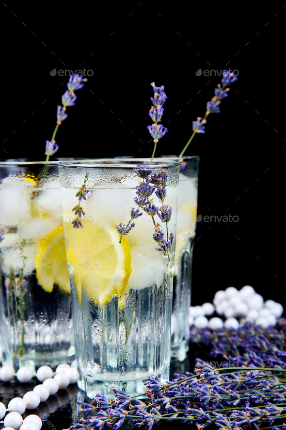 Lavender lemonade with lemon and ice - Stock Photo - Images