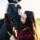 Young girl kissing bay horse's muzzle. - PhotoDune Item for Sale