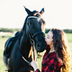 Black horse kissed by a young woman. - PhotoDune Item for Sale