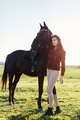 Black horse and an attractive young woman - PhotoDune Item for Sale