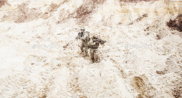 Infantrymen ready for fight moving in desert - Stock Photo - Images