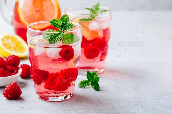 Cold drink Raspberry Lemonade with mint in glass. - Stock Photo - Images