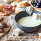 Bowl of fondue with appetizers - PhotoDune Item for Sale