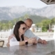 Young Couple Flirting at the Bar on the Pier. Young Couple Watching Photos on Your Phone and Talk at - VideoHive Item for Sale