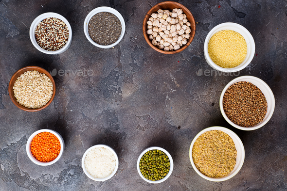 Superfoods and cereals selection in bowls on grey concrete background - Stock Photo - Images