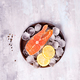 Salmon steaks on ice with lemon slice on wooden plate - PhotoDune Item for Sale