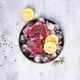 Fresh raw meat beef on a wooden plate with lemon slice and ice. Lean proteins. - PhotoDune Item for Sale