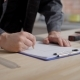 Constructor Is Drawing a Project on a Sheet of Paper Using Pencil,  of Hands on a Table - VideoHive Item for Sale