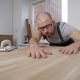 Master Is Checking Smoothness of Polished Surface of Wooden Boards, Stroking It By Hands and - VideoHive Item for Sale