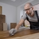 Adult Man Is Covering Timber Boards By Varnish in a Room of His Home, Woodworking and Furniture - VideoHive Item for Sale