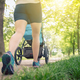 Walking woman with baby stroller enjoying summer in park - PhotoDune Item for Sale