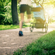 Running woman with baby stroller enjoying summer, motion blur - PhotoDune Item for Sale