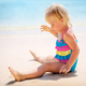 Baby girl playing on the beach - PhotoDune Item for Sale