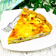 Quiche with pumpkin and bacon in white plate on table - PhotoDune Item for Sale