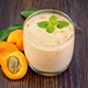 Milkshake apricot in glassful on board - PhotoDune Item for Sale