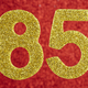 Number eighty-five golden color over a red background. Anniversary. Horizontal - PhotoDune Item for Sale