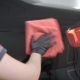 Master Is Polishing a Rear Part of Automobile By Red Soft Cloth in Auto Workshop After Washing - VideoHive Item for Sale