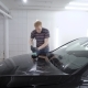 Master Is Polishing Surface of Black Car and Applying a Protective Layers of Nanoceramics in a - VideoHive Item for Sale
