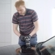 Redhead Male Worker Is Processing Surface of Car By Polishing Machine in a Car-service, Covering By - VideoHive Item for Sale