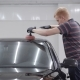 Master Is Grinding a Roof of Clean Black Automobile During Making Protective Covering in a Garage - VideoHive Item for Sale