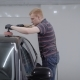 Redhead Man Is Using Polishing Machine for Smoothing Surface of Car, Touching By Tool a Roof of Auto - VideoHive Item for Sale