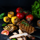 Grilled pork steak and vegetable , baked potatoes and green salad on dark - PhotoDune Item for Sale
