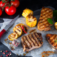 Three types of grilled meats with vegetables and spices on paper - PhotoDune Item for Sale