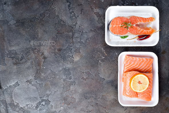 two fresh raw salmon steaks are laying on white food tray made from polystyrene foam - Stock Photo - Images
