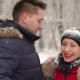 A Caring Man Removes the Snow From the Girl's Hat - VideoHive Item for Sale