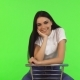 Happy Teenage Girl Sitting on a Chair Smiling To the Camera - VideoHive Item for Sale