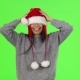 Shot of a Charming Santa Claus Girl Having Fun at Studio - VideoHive Item for Sale