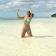A Woman in a Swimsuit Makes a Selfie on the Seashore - VideoHive Item for Sale