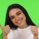 Happy Girl Showing Thumbs Up on Green Background - VideoHive Item for Sale