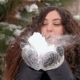 Pregnant Girl Blowing on Snow in Winter Park. - VideoHive Item for Sale