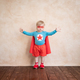 Superhero child playing at home - PhotoDune Item for Sale