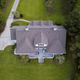 Aerial view of large home with new roof on beautiful property. - PhotoDune Item for Sale