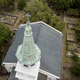 Aerial closeup view of church steeple and cross. - PhotoDune Item for Sale