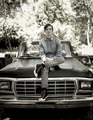 Portrait of young man sitting on old pickup truck - PhotoDune Item for Sale
