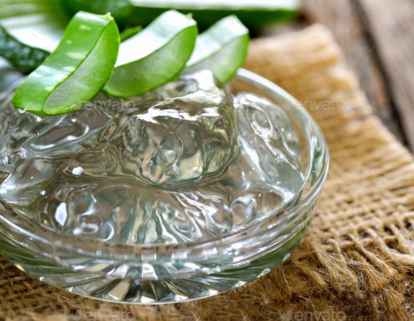 aloe vera gel in bowl with on wooden table - Stock Photo - Images
