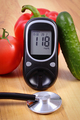 Vegetables, glucometer for checking sugar level and stethoscope