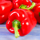 Fresh peppers lying on purple boards, concept of healthy nutrition - PhotoDune Item for Sale