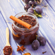Fresh plum marmalade in jar, ripe fruits and spices on boards, healthy sweet dessert - PhotoDune Item for Sale