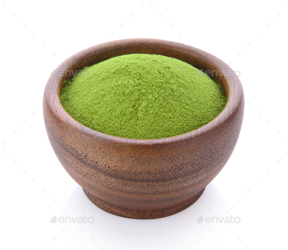 green tea powder in wood bowl on white background - Stock Photo - Images