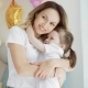 Little Girl Hugging with Mom. A Woman Kisses Her Little Daughter - VideoHive Item for Sale