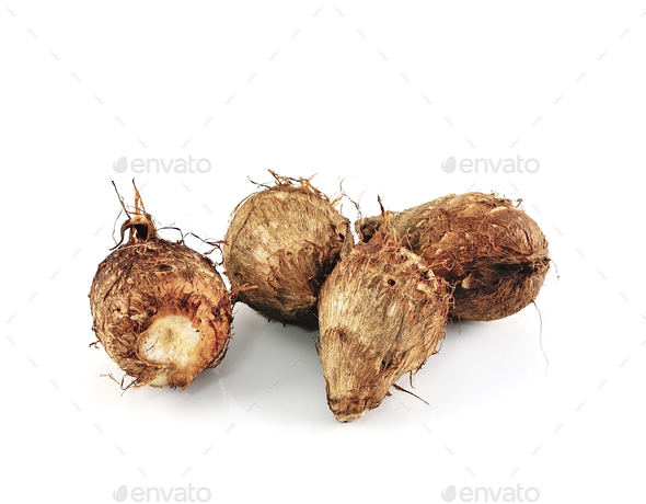 taro roots on white background - Stock Photo - Images
