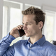 Businessman in office having a conversation on a mobile phone - PhotoDune Item for Sale