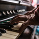 Old man playing the piano in a close up view of his wrinkled han - PhotoDune Item for Sale