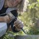 Senior sculptor sculpting in stone outdoors - PhotoDune Item for Sale
