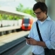 Young Businessman Texting Waiting for Train on Platform, Summer - VideoHive Item for Sale